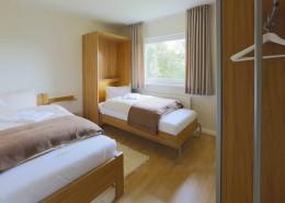 Ferienwohnung Akelei Schlafzimmer Zustellbett